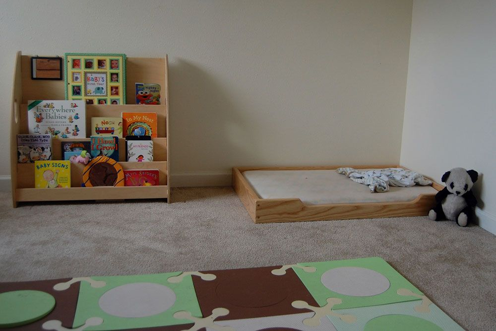 Montessori floor bed with low wood frame via Bedstart Montessori