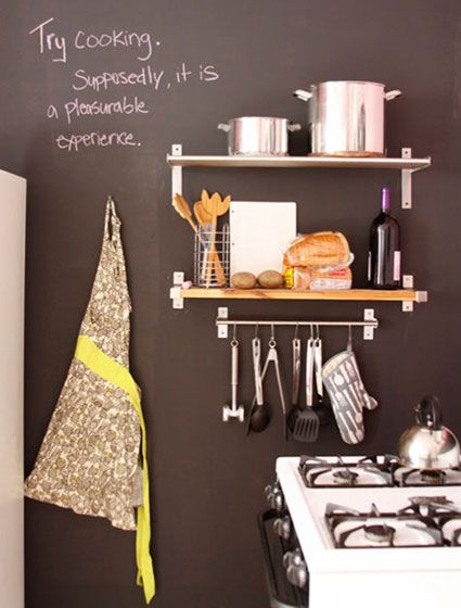 Simple kitchen with retro accents chalk board apron shelving
