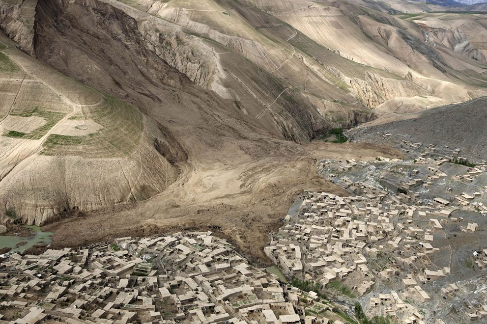 An aerial view shows the site of the landslide that buried Abi Barik village on May 5, 2014. Hundreds of people were killed in a horrific la...