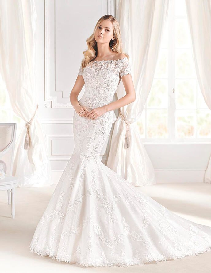 eea53cd295 Dreamy lace mermaid gown with removable bolero takes your dress from  ceremony to reception. Perfect for church weddings if you need to cover up  or if you ...