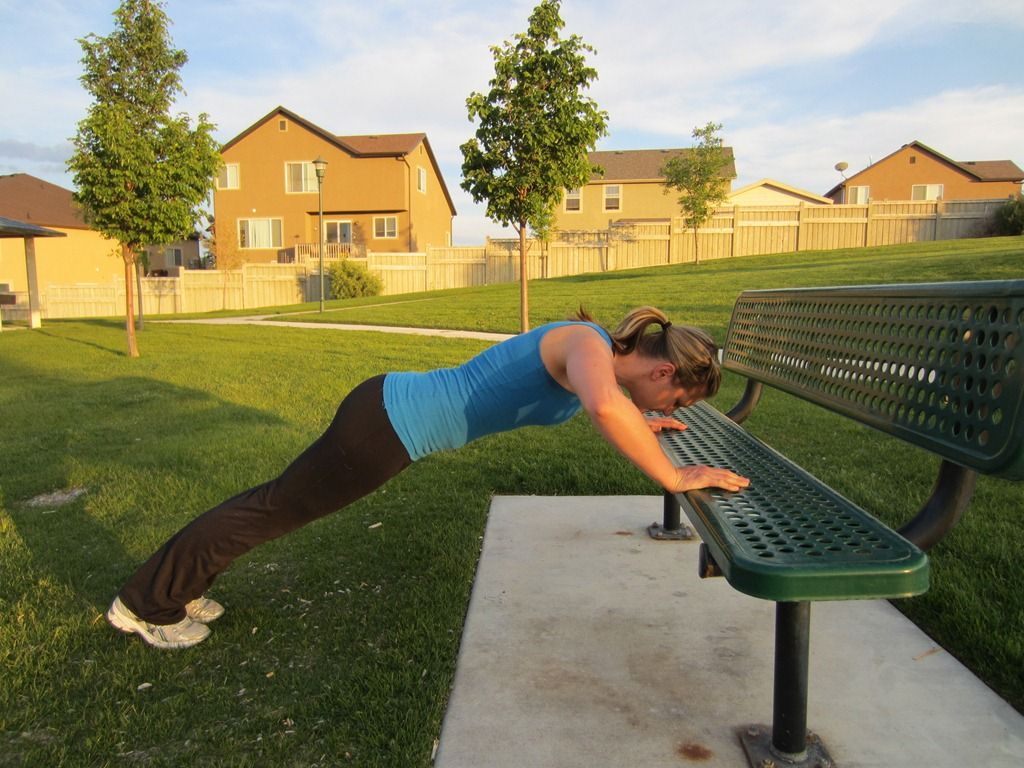 Find a bench and place hands on the bench just outside of your shoulders.  Do a pushup until your nose is right above the bench.  Keep your body straight!