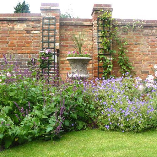 Houzz brick walled garden the old brick feature boundary for Garden brick wall designs