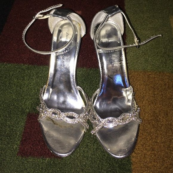 Silver diamond heels Silver heels with diamonds on the front. Only worn once. A little dirty but easily can be cleaned other than that they're in good condition. Shoes Heels