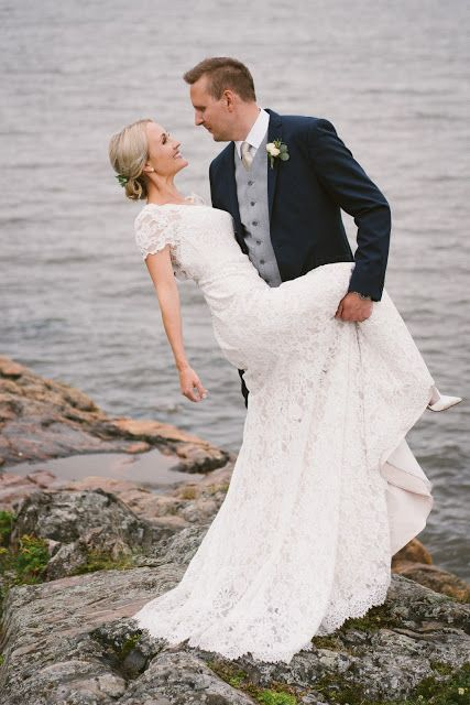 Real wedding in Finland. Dress made by Pukuni (www.pukuni.fi). Wedding dress with lace and short sleeves. Photography / Jukka Alasaari Photography.