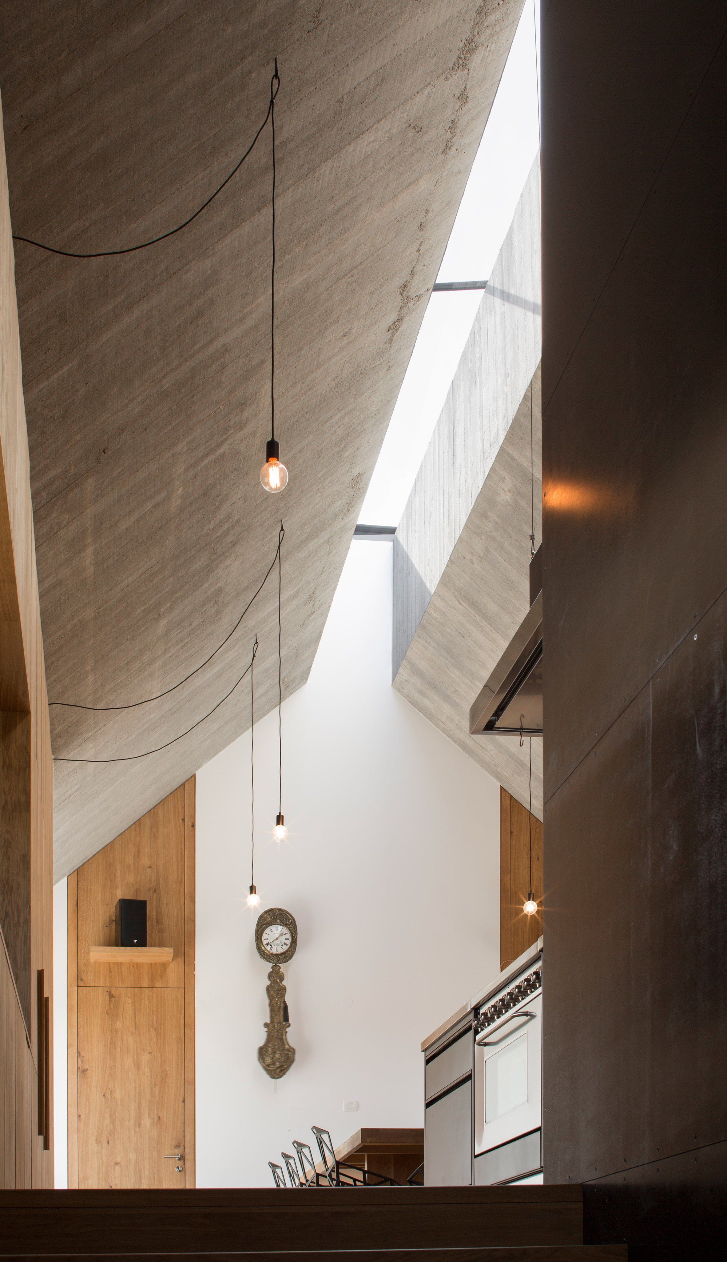 Dekleva Gregoric Arhitekti Has Extruded The Shape Of A Chimney Along The Top Of This House In Slovenia Creating Roof Design Residential Building Design House