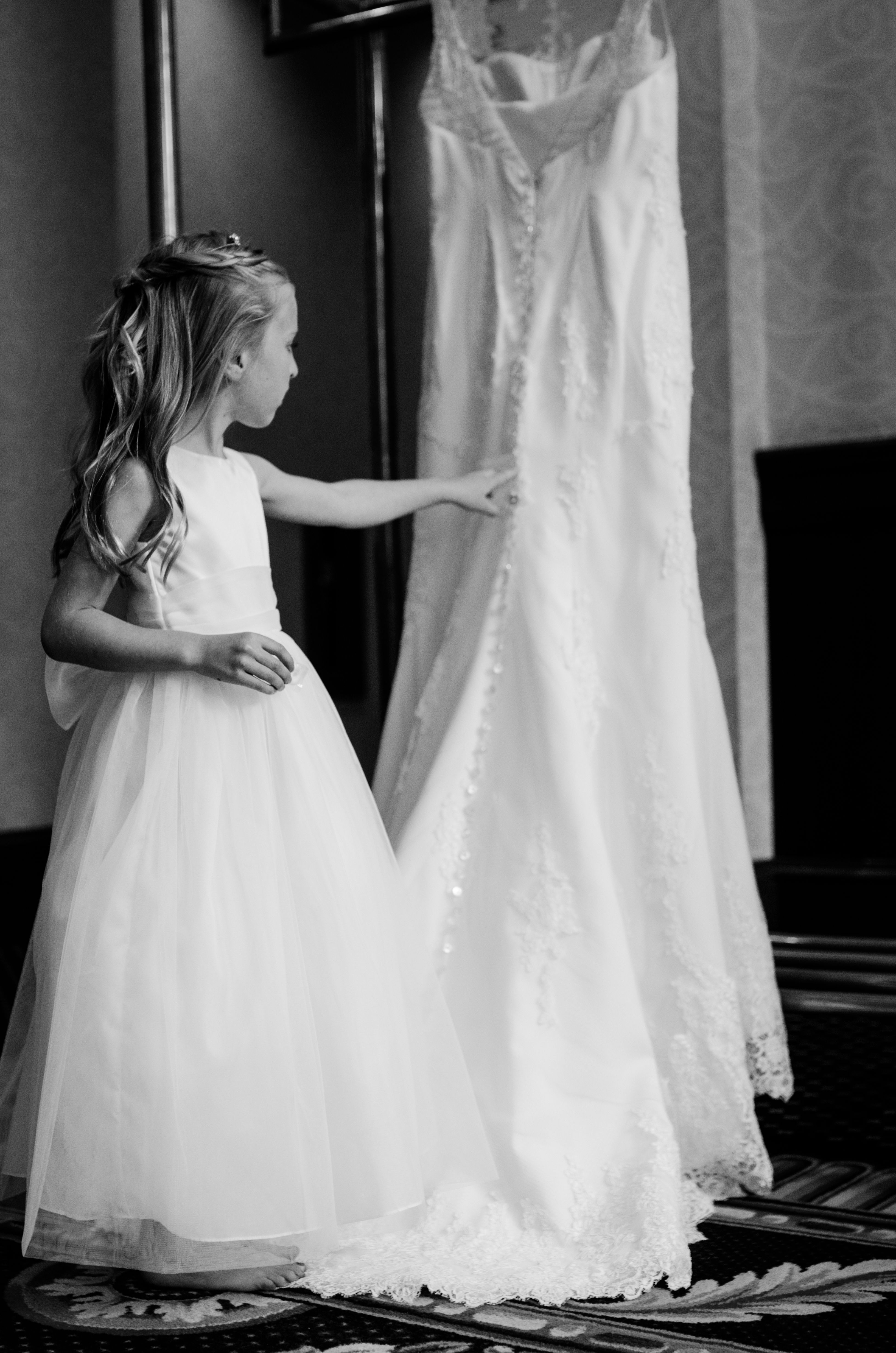 Wedding dresses for black girls  Flower girl counting the buttons on the brides dress  Indianapolis