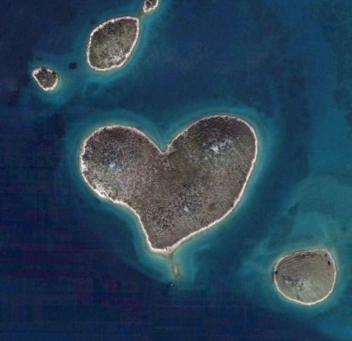 """A heart shaped Croatian Island. It is lined on every side with golden sands. It is located in Zadarski Kanal (Zadar Channel) between Zadar and Island of Pasman. The Island, named 'Galesnjak' is 130,000 square yards and its unusual shape was only made prominent as a result of Google Earth. The owner of the Island, which has now been dubbed """"Lovers Island"""", is said to be swamped with people wanting to stay there. Photo courtesy of Google Earth"""