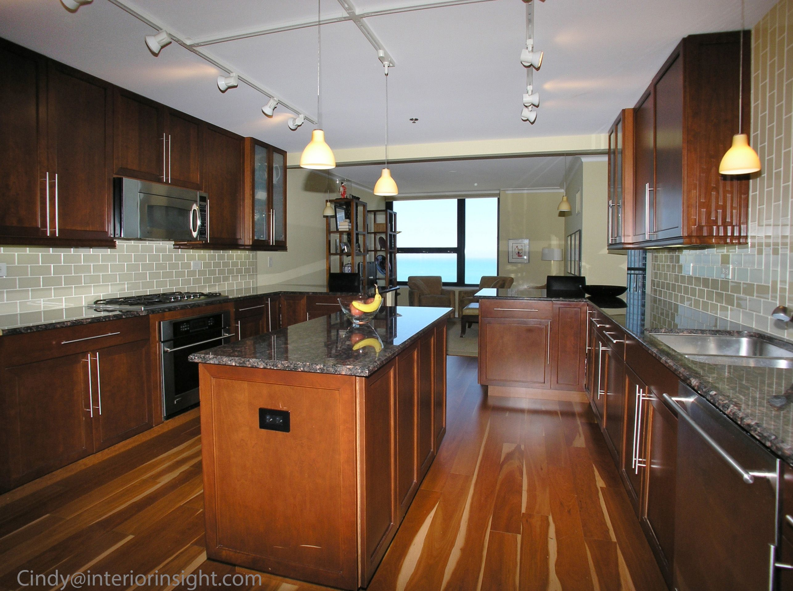 Amazing Chicago Loft Kitchen with custom cabinets multi colored wood