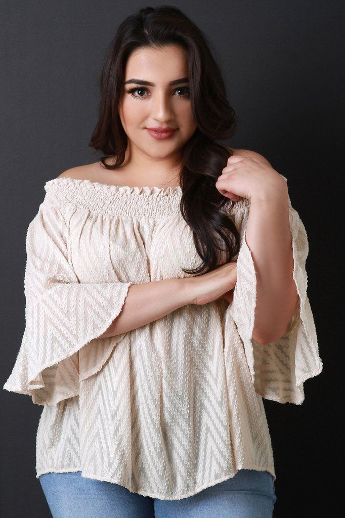This plus size top features a smock off the shoulder neckline, quarter-length bell sleeves, swing cut fit, and chevron texture design on semi-sheer fabrication. Accessory sold separately. Made in U.S.A. 100% Polyester.