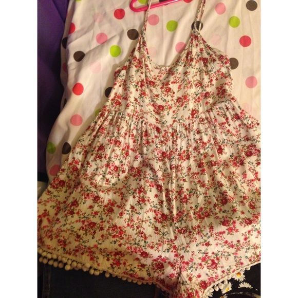 floral romper floral & has pom poms at the end. bought from another person but too small Forever 21 Other
