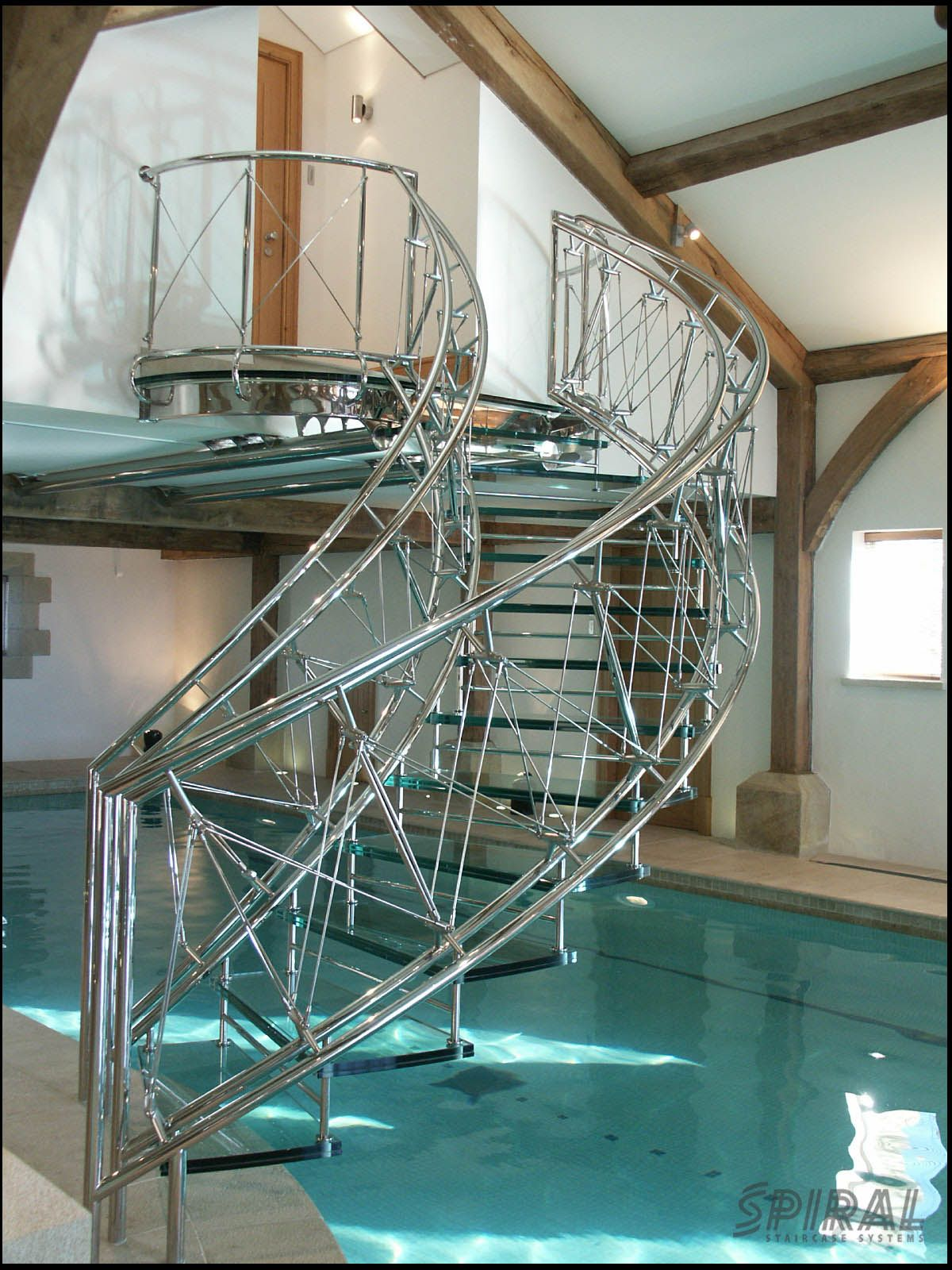 Helical Stair Over A Swimming Pool. Wendeltreppen Aus Einem