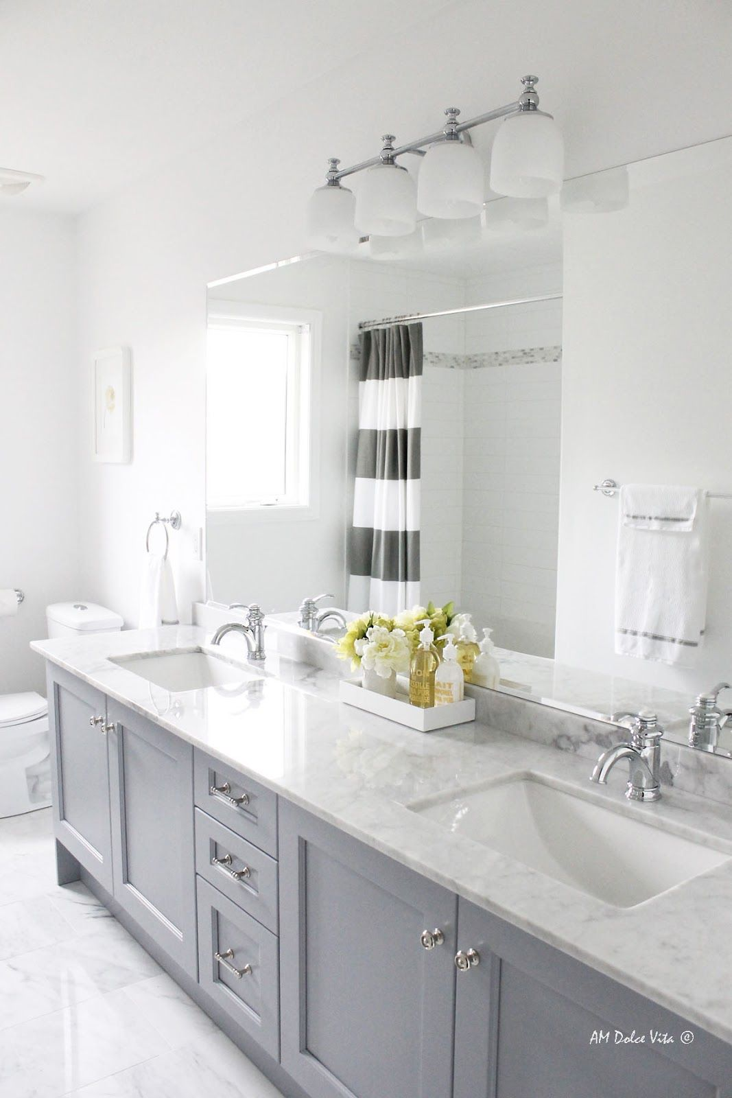 Idea for my master bath? Yes please! I love the gray cabinets ...