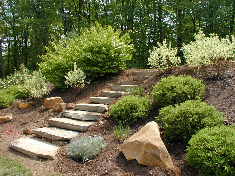 Capstone stepper garden pinterest landscaping for Hillside rock garden designs