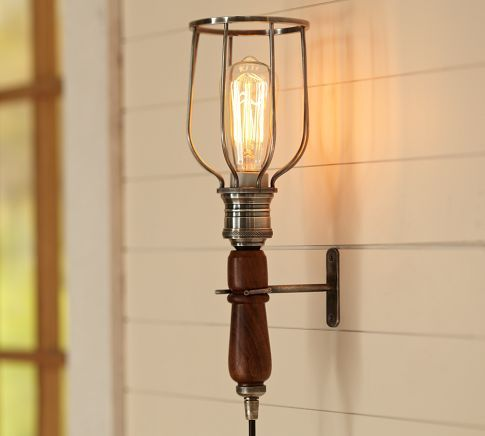 Monroe Caged Sconce Built To Look Like Portable Lighting