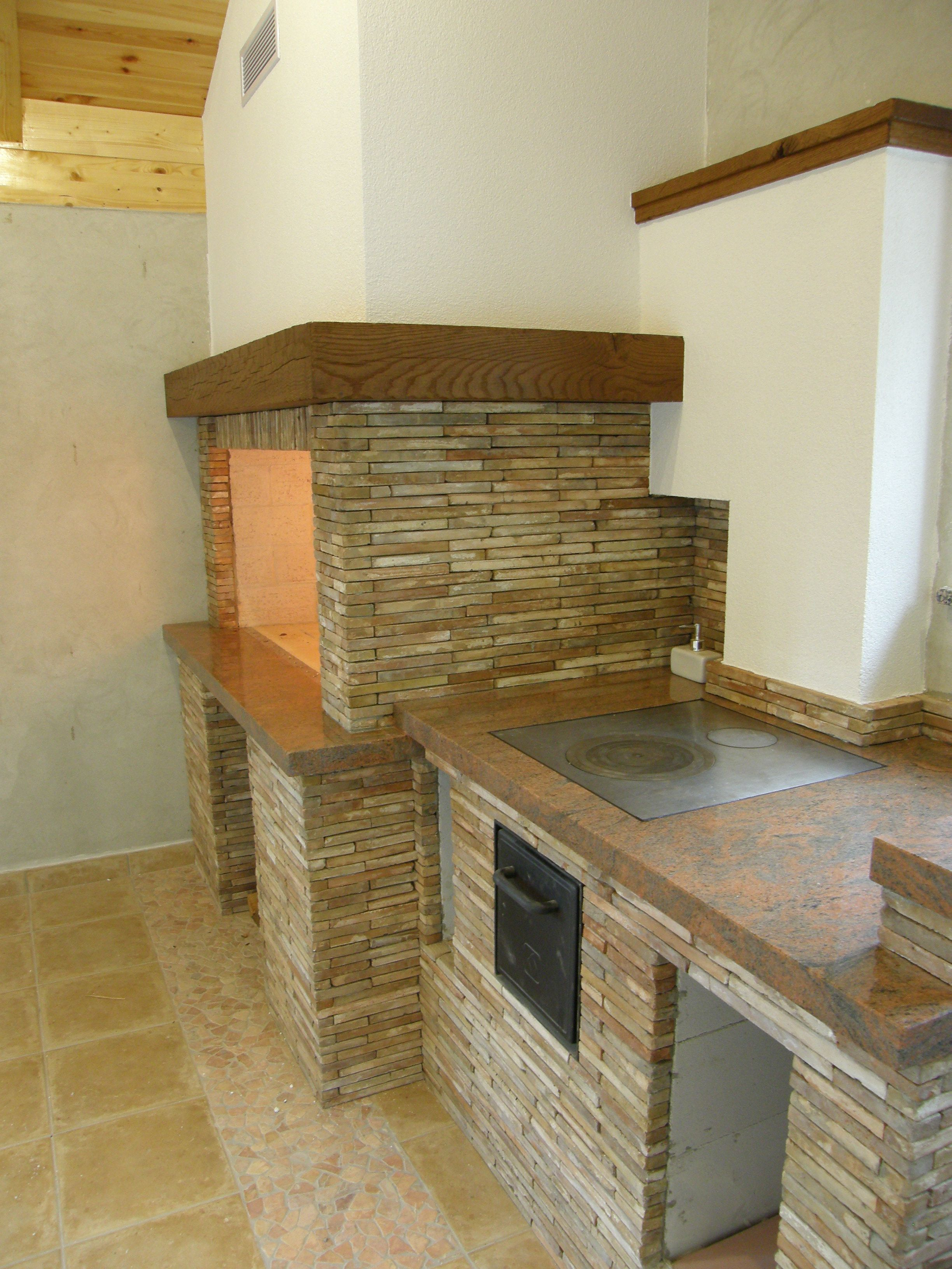 Fireplaces And Kitchen Range Stone Multicolor And Oak Beams Design