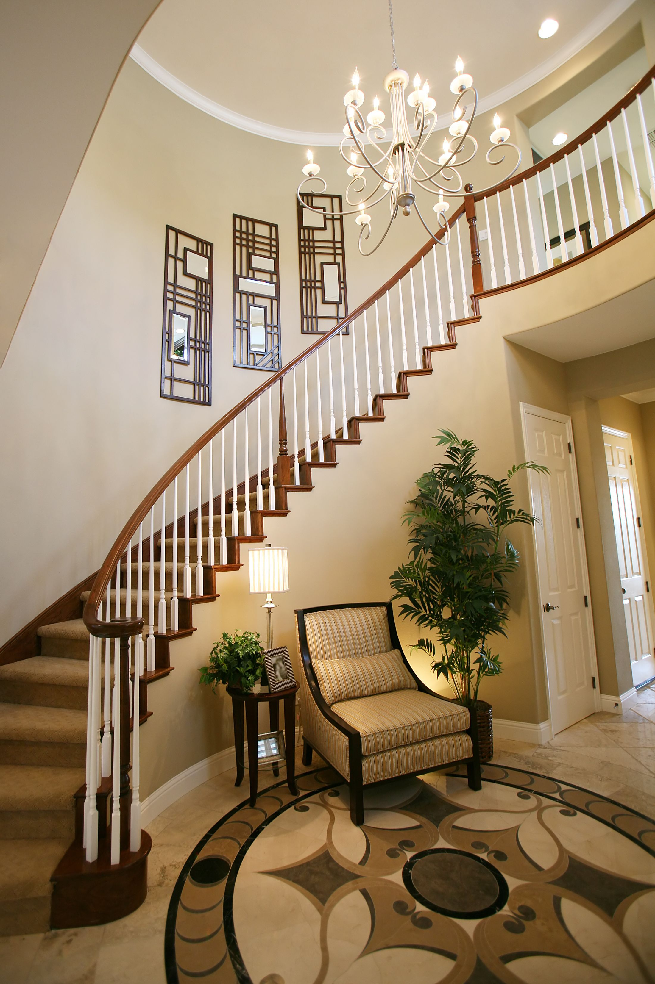 home interior design stairs%0A Elegant chandelier complements the classic look of the staircase  Beautiful  HomesBeautiful Home InteriorsEntryway