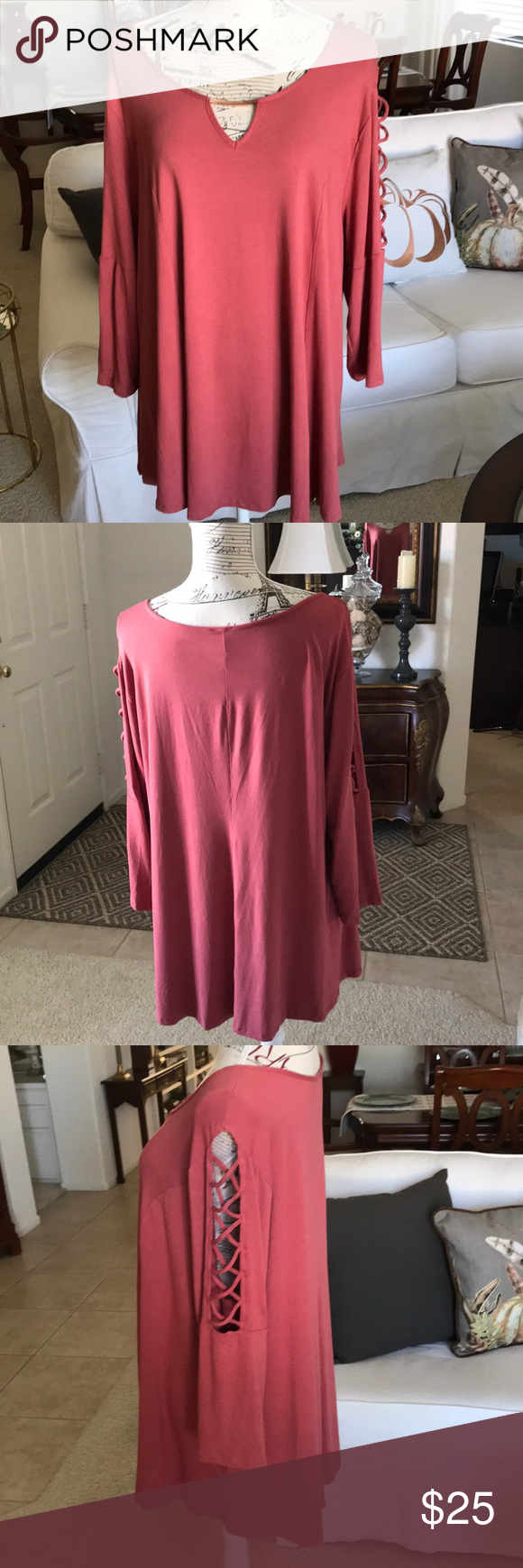 The picture perfect top for fall You will love this top and wear it often. It's that great longer figure flattering length we all love. It's a bea…