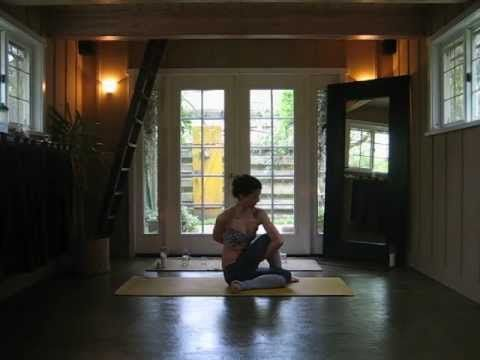 variation of crow pose and tripod headstand with ankles