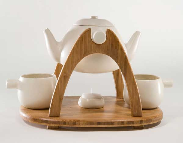 Tea for two-notice teapot has two spouts. You don't have to pick up the hot tea pot. You just tilt to what ever side you're filling. Extremely clever!