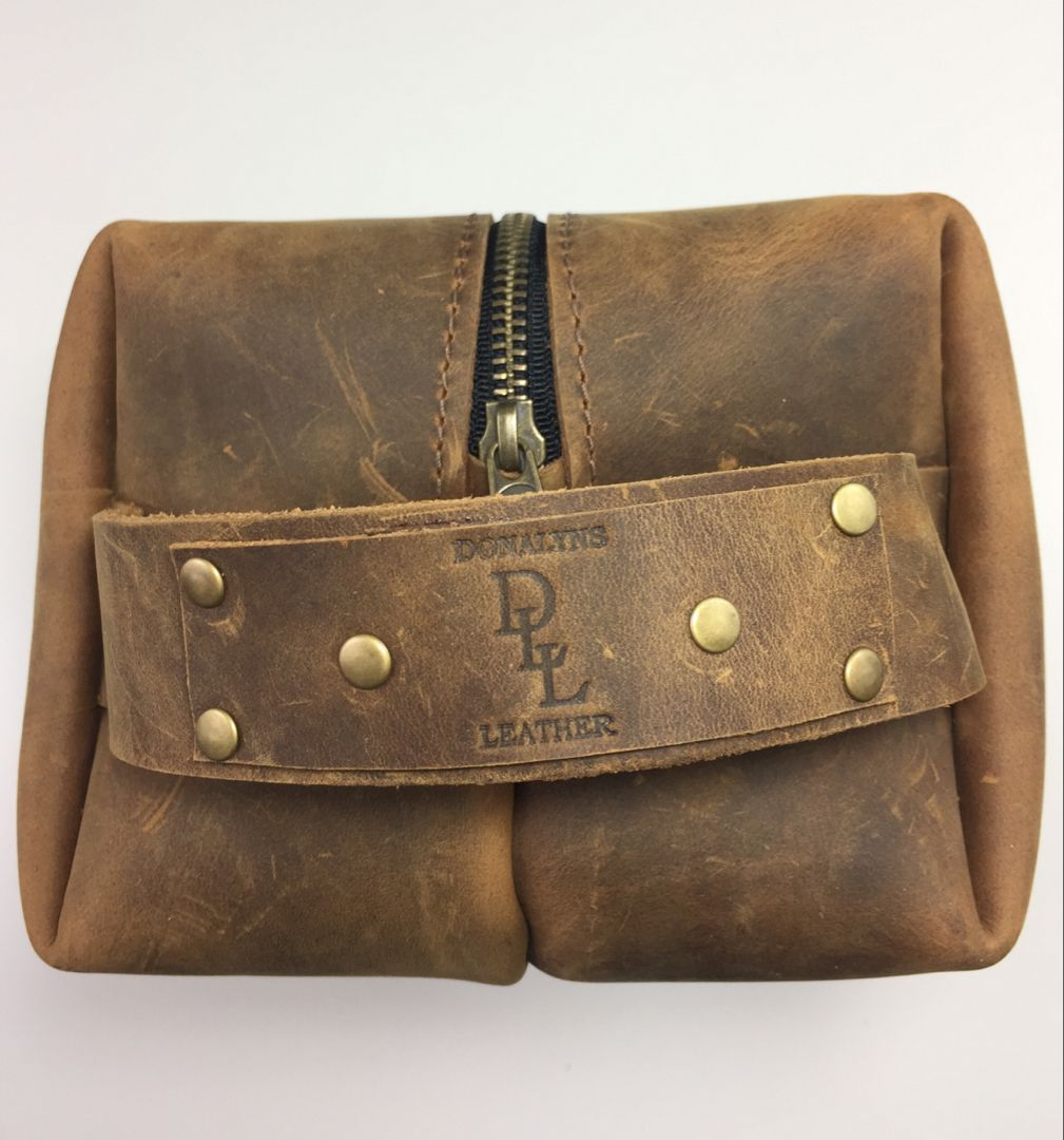 This is a genuine leather Dopp kit shaving kit ditty