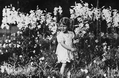 Princess Elizabeth playing in the flowers.