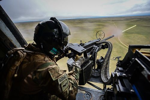 A door gunner fires his machine gun during Exercise Prairie Storm 3 at the British Army Training Area Suffield (BATUS) Alberta Canada. & Jamie L. Harding | Door gunners | Pinterest | Bullets Posts and Doors pezcame.com