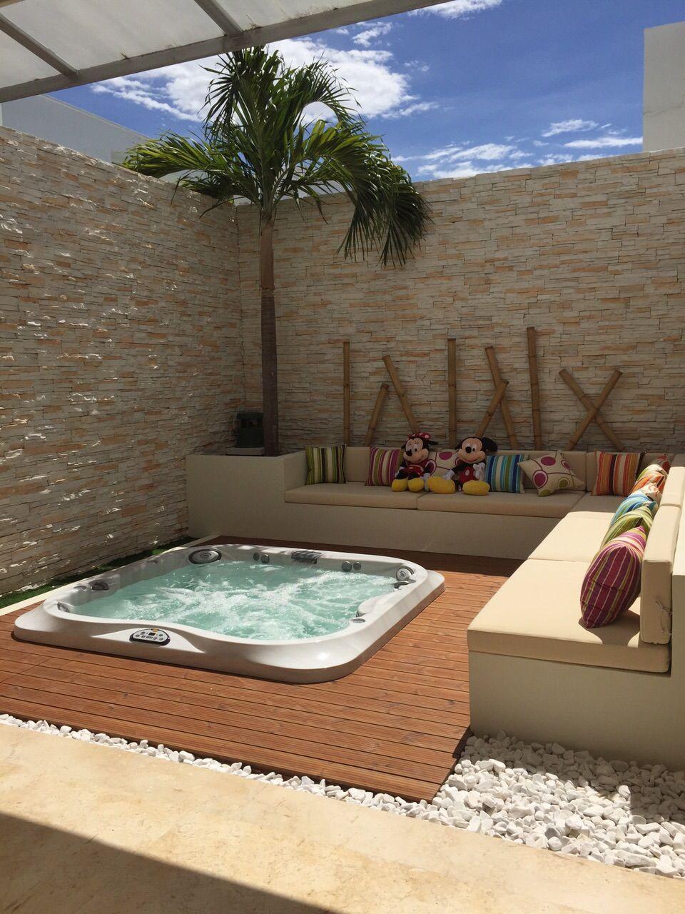 Proyecto construido terraza jacuzzi exterior for Jacuzzi piscina exterior