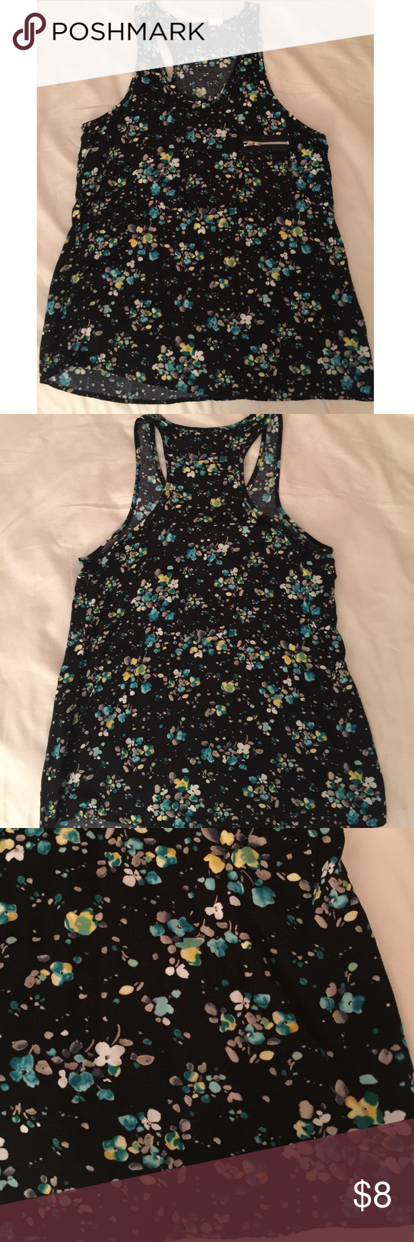 Adorable top barely worn Barely worn perfect condition- adorable black top with racer back body- beautiful abstract floral print all over with zippered front pocket (actually is a pocket too!). Can fit a M.    💥BUNDLE to save 20%💥 Tops Tank Tops