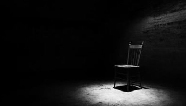 Chair In A Dark Room With A Single Light
