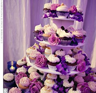 A tower of sweet cuppin' cakes!  I like the color detail with the roses and the votives.