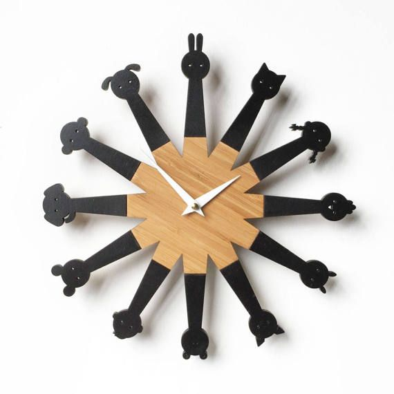 This stylish wall clock featuring 10 animals can you guess who