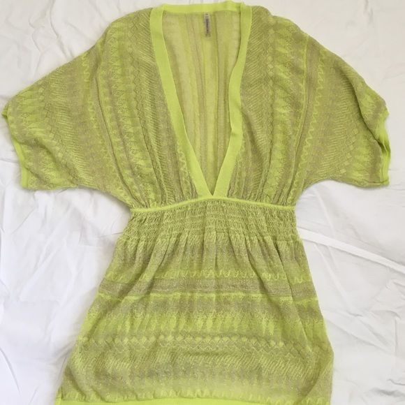 Victoria's Secret Cover Up Short sleeve coverup in a lime color with silver metallic details. Low plunging v-neck with elastic waistband. 47% linen, 29% viscose, 16% polyester and 8% metallic. Like new. Victoria's Secret Swim Coverups