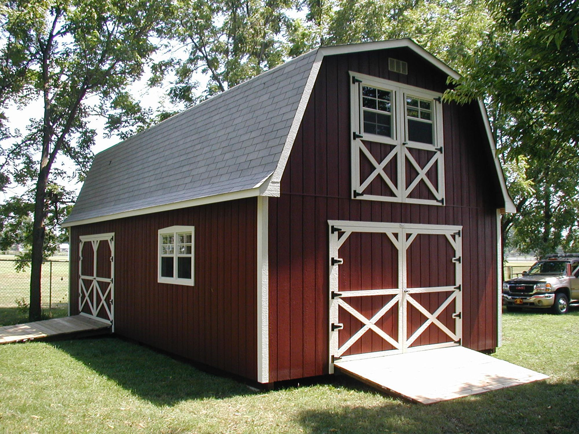 A red two story storage building shed to tiny house