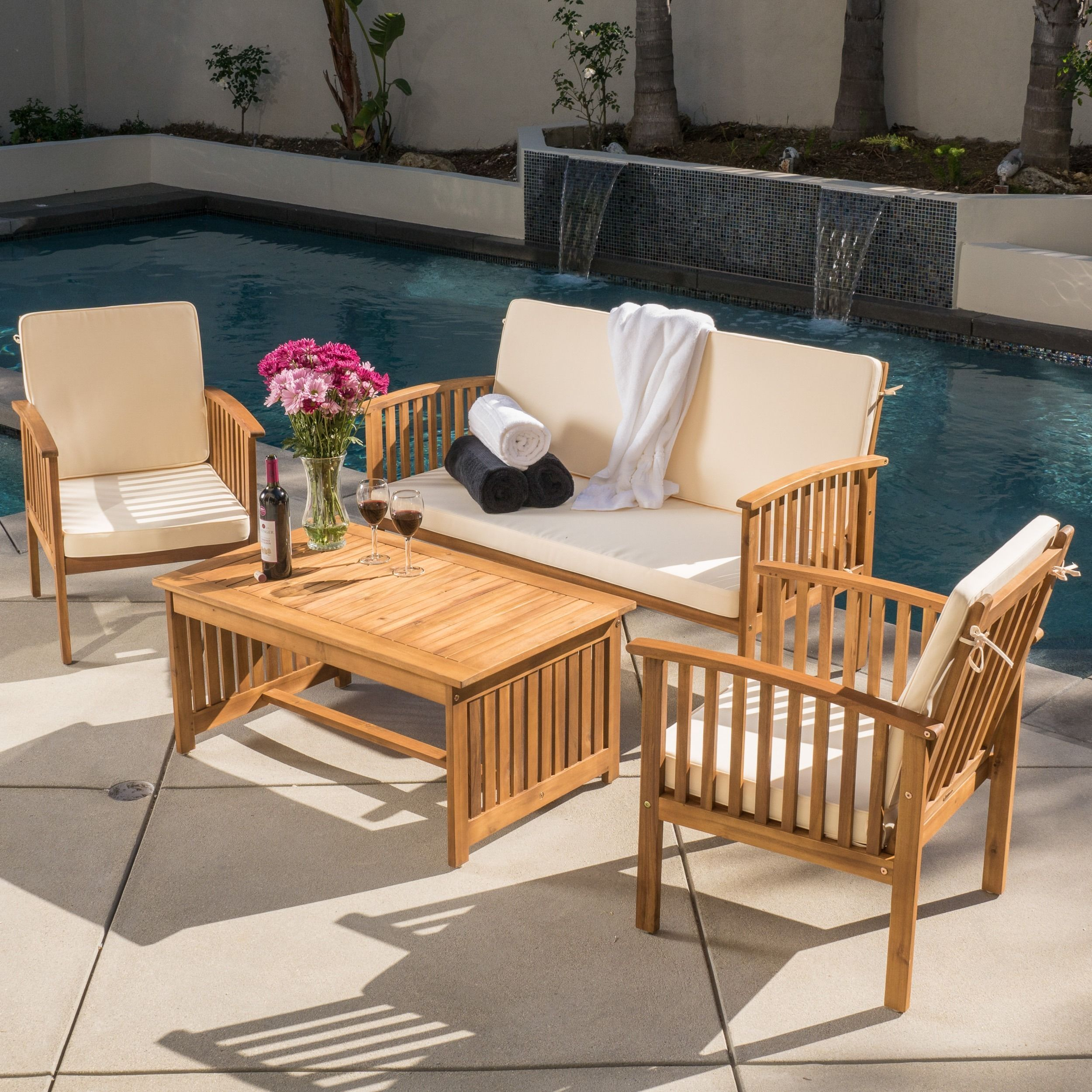The carolina fourpiece outdoor acacia sofa set offers all the