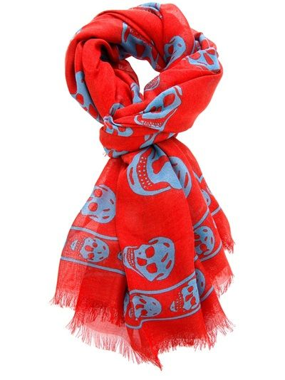 Red and sky blue print scarf from Alexander McQueen featuring a contrast skull print design, a frayed edge and designer embossing.