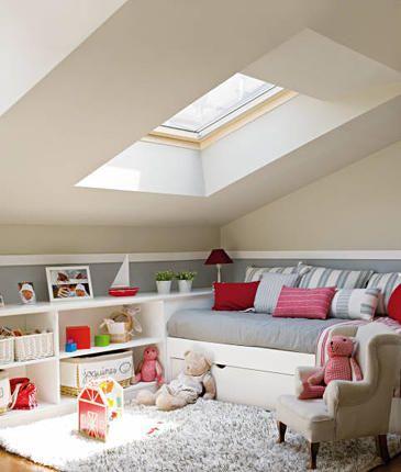 Cozy Attic playroom built-in storage + daybed + shag rug + skylight