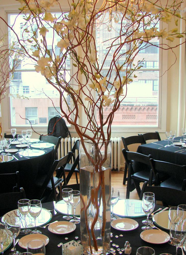 This Is A Tall Centerpiece Featuring Curly Willow Branches And White Orchid Branch Centerpieces Wedding Tall Wedding Centerpieces Picture Wedding Centerpieces