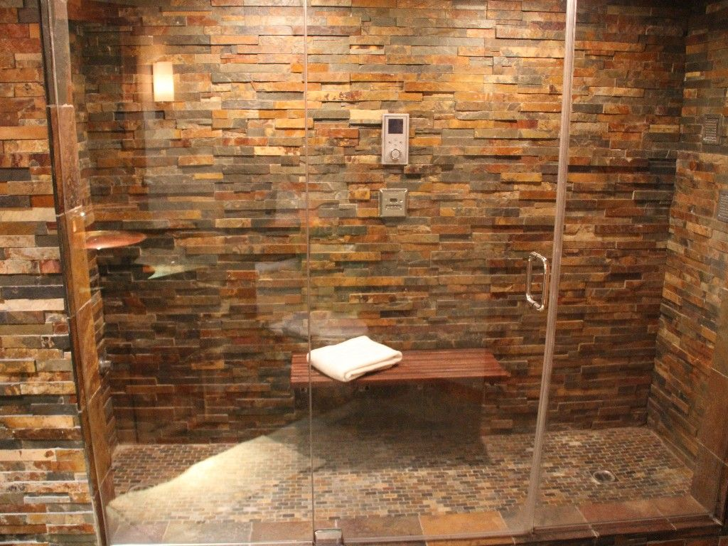 6 Advantages Of Using Natural Stone During A Shower Remodel Stone Shower Shower Remodel Stone Shower Walls
