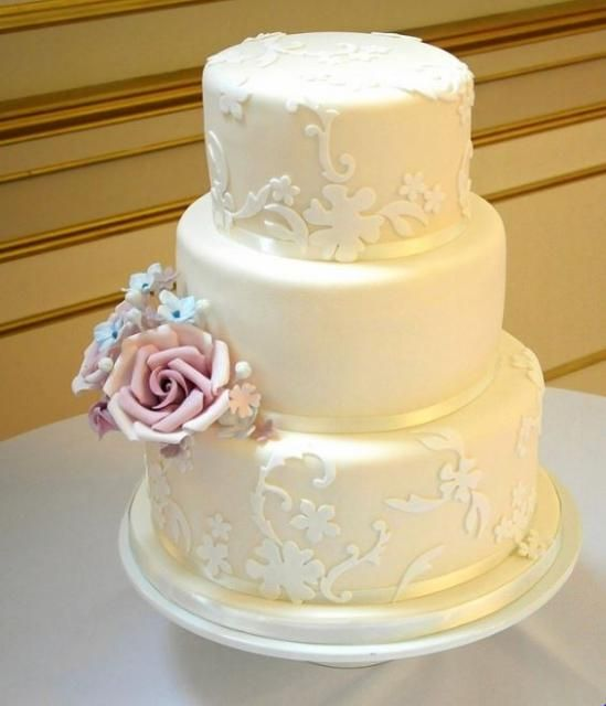 Ivory 3 tier wedding cake with pink rose on second tier.JPG ...