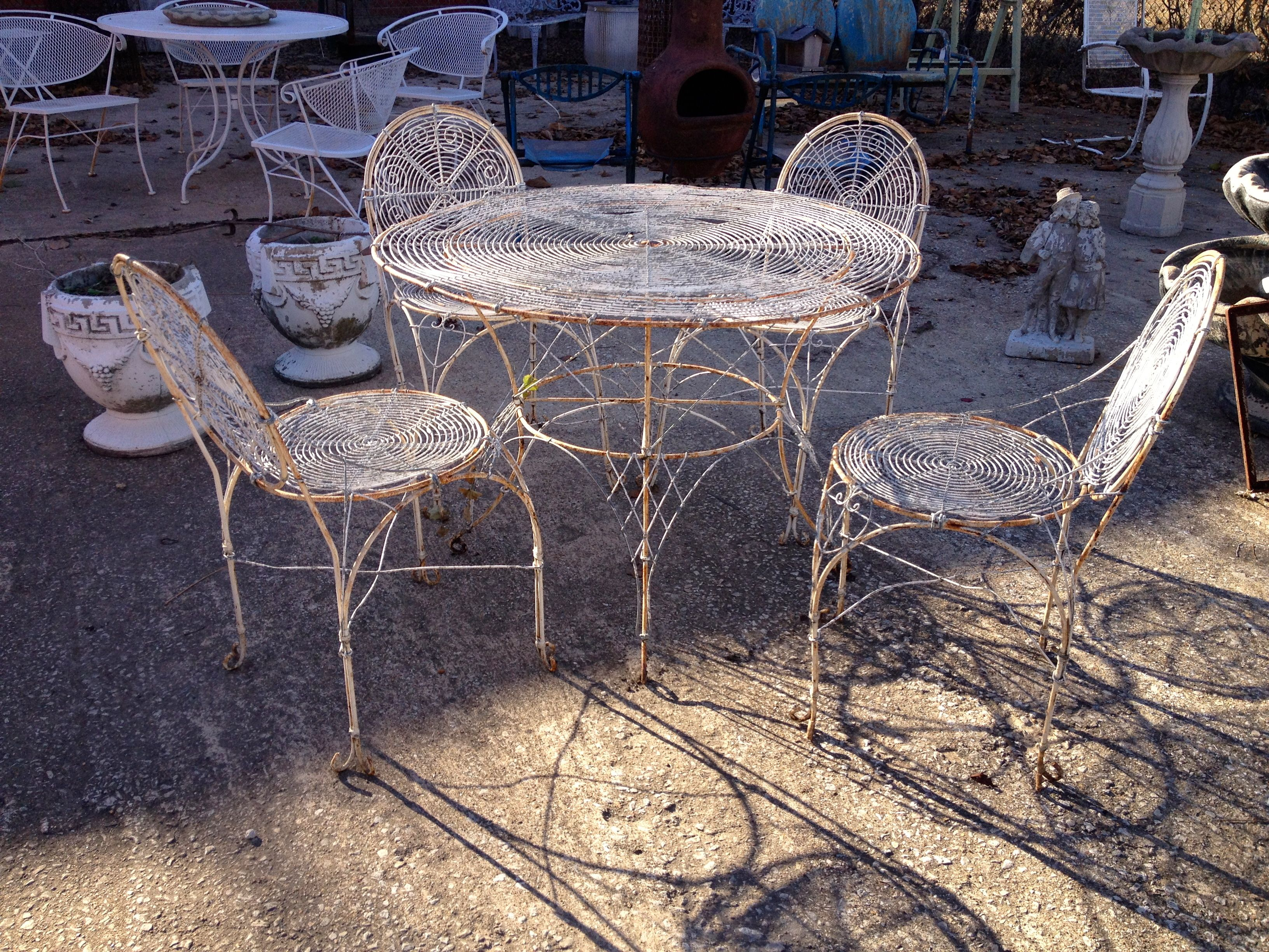 Vintage Distressed Metal Patio Set Table and Four Matching Chairs