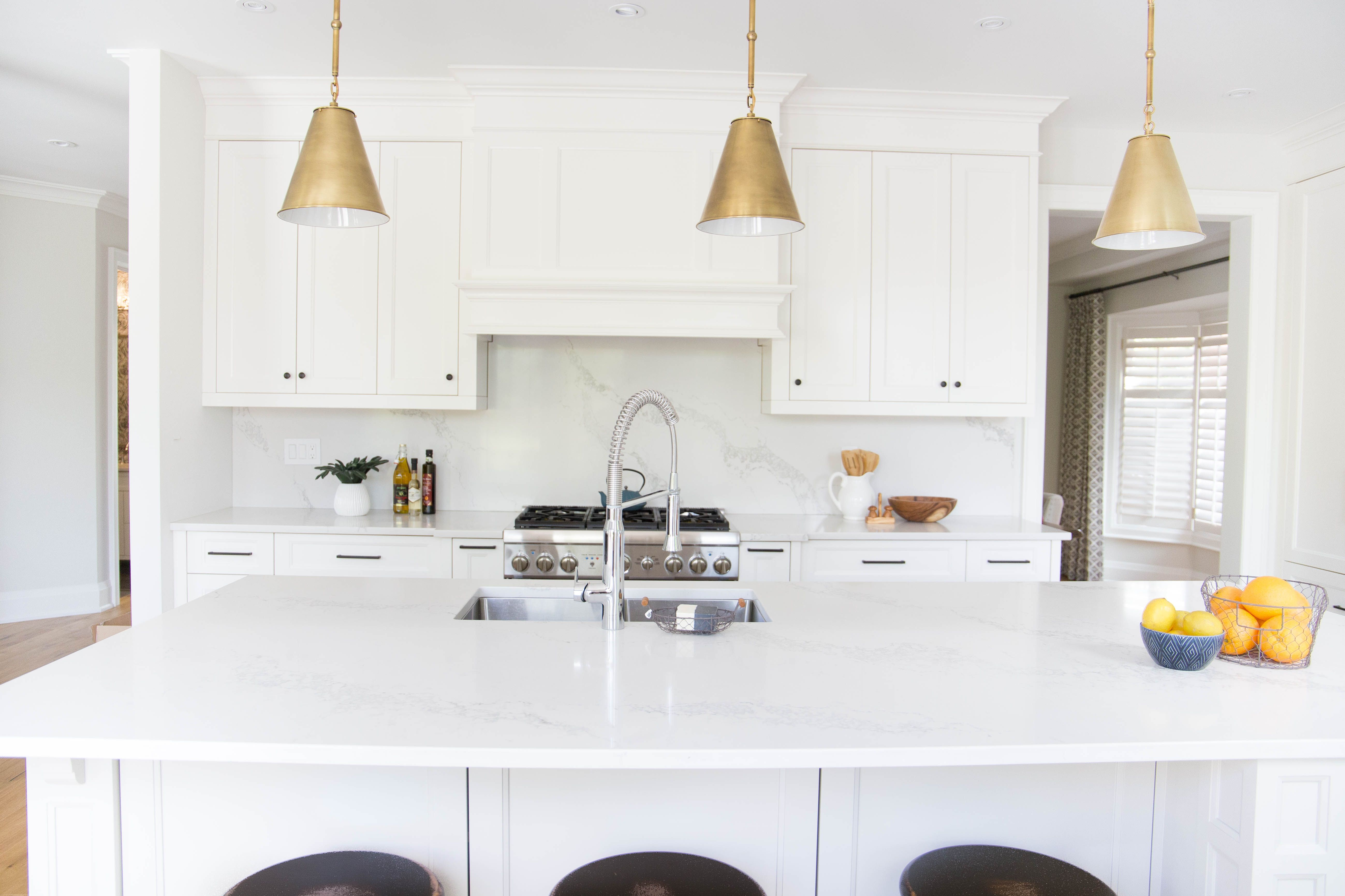 Beautiful White Kitchen With Large Island Marble Backsplash And