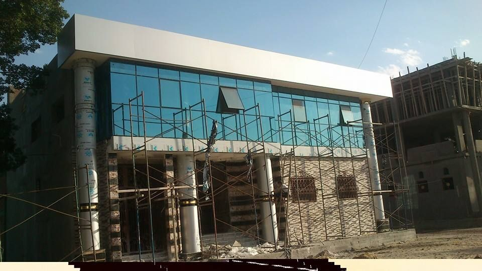 كرتن وول واجهات زجاجية Cladding Structures Road