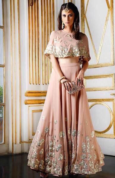 5b4dee4b9d7a Astha Narang blush colored lehenga with gold details and cape top ...