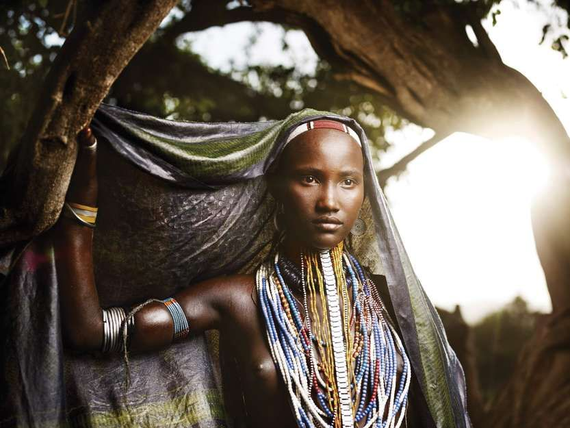 Arbore women (Ethiopia) are known for their long headdresses. The girls shave their heads to indicate virginity, and only start growing hair after marriage.