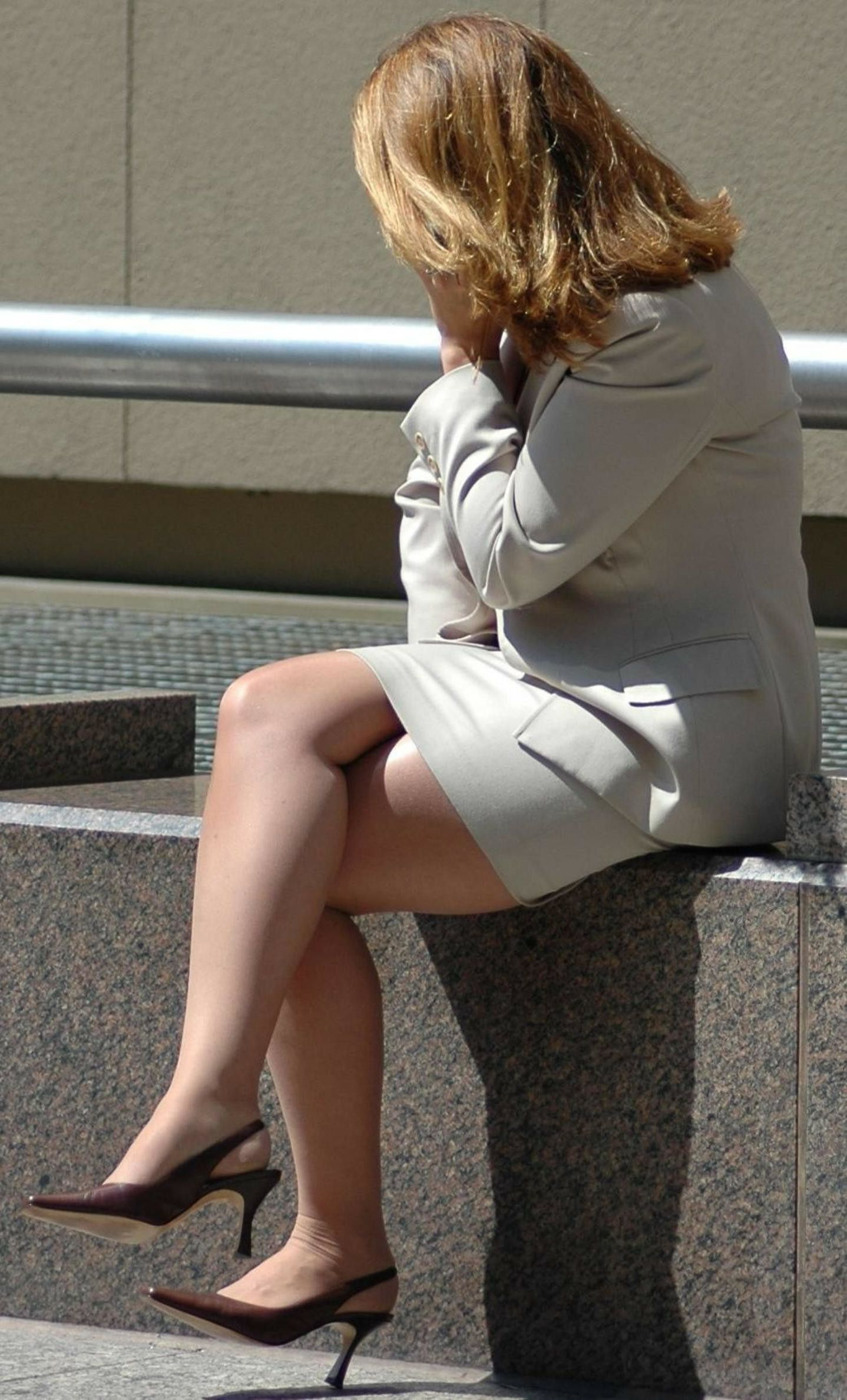 candid mature office girl wearing pantyhose and heels with her legs