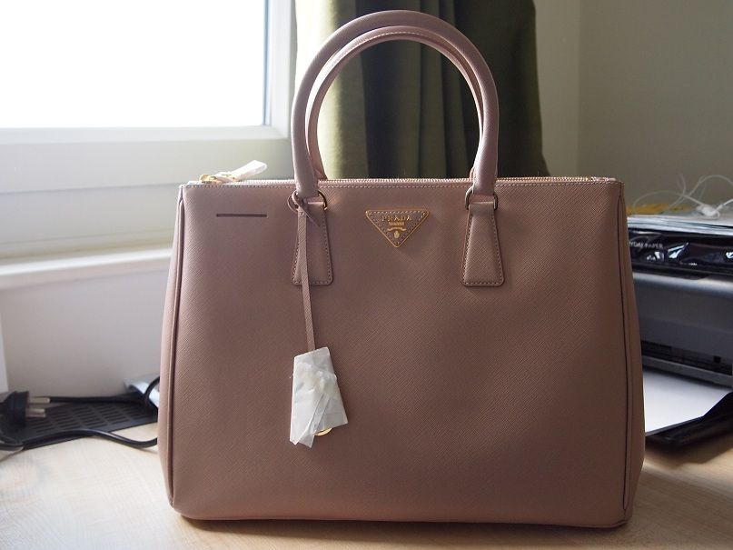 a064bf115272 Prada Saffiano Lux Size   BN1786 (L 26 H 35.5 W 15 cm) Colour  Cameo. Used  to own this