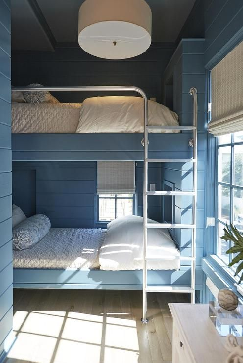 Blue Cottage Boy S Room Features Walls Clad In Blue
