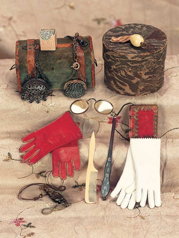 lorgnete with faux-tortoise handle,1 folding embossed lorgnette,red velvet book cover,two small mesh purses,red kidskin gloves,cream kidskin gloves,playing cards,bone darning egg,green velvet and leather valise (originally candy container),and paper-covered hat box (originally candy container). All excellent condition. French,circa 1875. #dollaccessories