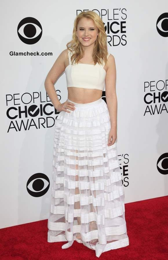 Taylor Sprietler in an all white crop top and long skirt ...