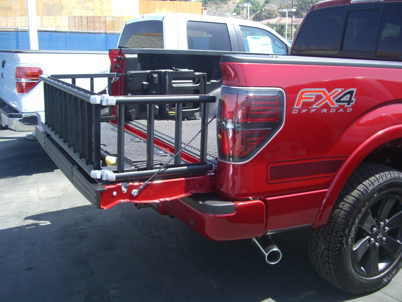 Bed extender motorcycle ramp combined